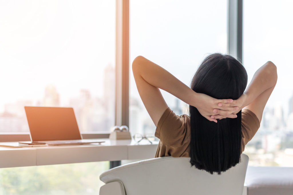 a women sitting relaxed in front of her computer