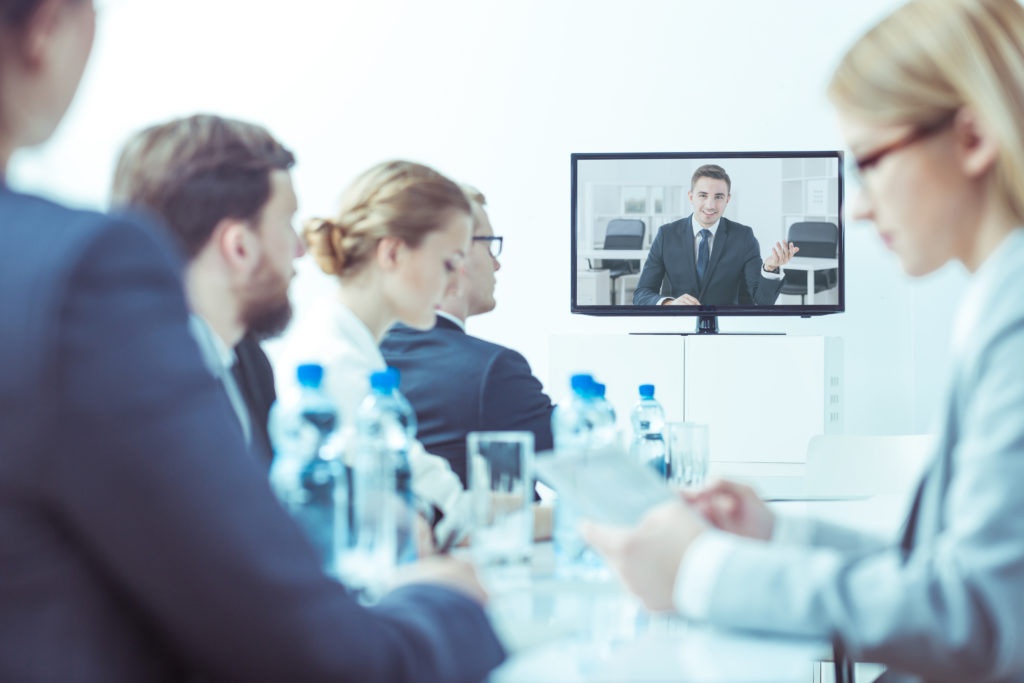 Video conference with employees at worldwide finance company